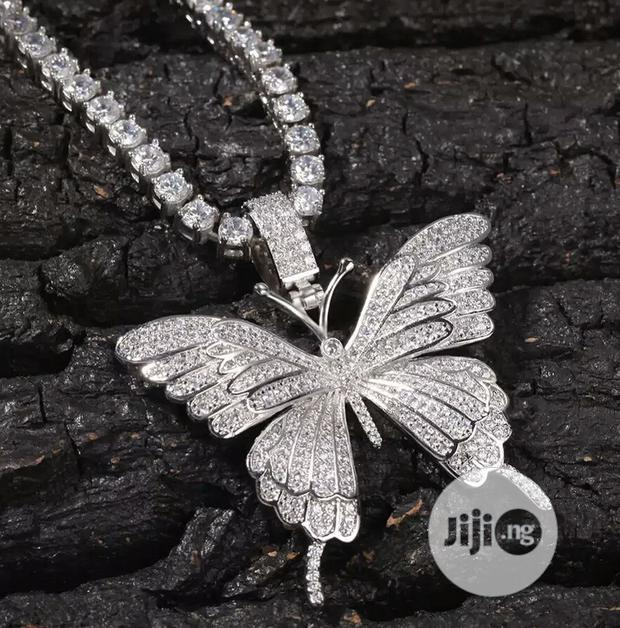 Iced-Out Butterfly Pendant With a Tennis Chain