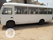 Standard Toyota Coaster Bus 2004 White For Sale | Buses & Microbuses for sale in Abuja (FCT) State, Lokogoma